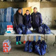 Merrimack College students Deidra Collins, Oscar Zepeda Cagide, and Jaime Cortes Torres helped distribute needs packs.