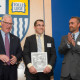 Lacrosse standout Greg Rogowski '09, center, is welcomed to the Hall of Fame by President Christopher Hopey, left, and Dir...