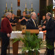 President Hopey, center, congratulates Associate Professor of Civil Engineering Marc Veletzos, right, as Father Raymond Dl...