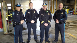 L to R Officer Joel Henriquez, Sergeant Sean Paterson, Chief Michael DelGreco, and Sergeant Rob Parnell pose in the Lawrence Fire Department Headquarters before marching in the parade.