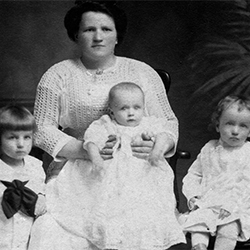 old photo of mom and three children.