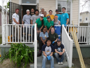 Students take a break and pose for a photo while volunteering in New Orleans during this year's Alternative Spring Break.
