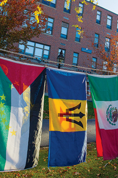 international flags outside at Merrimack College.