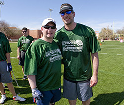 Incoming Professor Jonathan Jensen (left) with Aaron Rodgers at Kurt Warner's Ultimate Football Experience celebrity flag ...