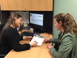 Student Services Specialist Kim Valente advises Caitlyn Garger '15