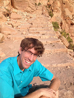 Incoming Professor Ryan Spalding pauses for a photo at the Grand Canyon during a road trip last summer.