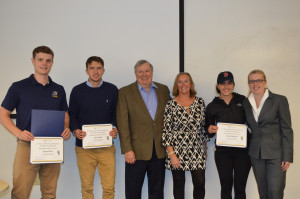 Business division winners Ryan Wine '17, Lars Sund '19, and Grace Messina '17 with Paul and Joyce Mucci and Lab Director Mary Papazian.