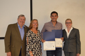 Non-business division winner Sergio Martinez '19 with Paul and Joyce Mucci and Lab Director Mary Papazian. Missing: J...