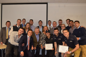 Winners of the Merrimack Madness Stock Trading Competition and Merrimack Investment Fund Challenge celebrate with the Merr...