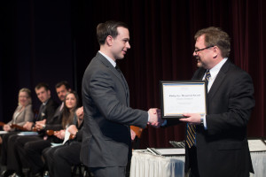 Shane Simbeck receives the Philip Lee Memorial Award from Dean Cordano at the SIE Induction Ceremony on April 6th, 2014