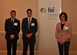 From left: Students Anthony Capobianco and Vince Bellino, FEI award winners, and Merrimack College Finance Professor Ana S...