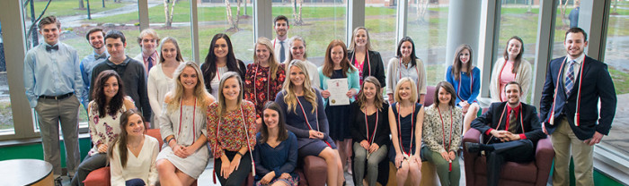 Group of students at Lambda Pi Eta Induction